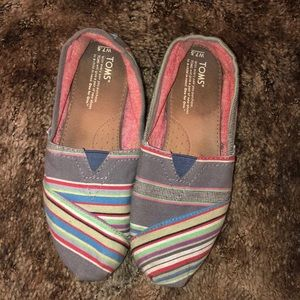 TOMs multi-colored slip-on's